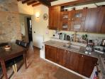 The well equipped kitchen with integrated appliances