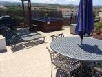 The private roof terrace with pergola, bbq, jacuzzi , sun beds and outside dining table
