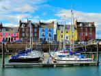 Stay in the yellow building with red door. Stunning views of harbour.