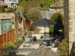 Relax in our suntrap of a cottage garden with a glass of wine!