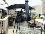 Terrace only for you with entrance directly from the Apt with swings, sun shade, dalmatian plants...