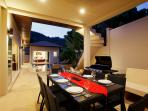Outdoor dining for 8 with gas BBQ and plenty of seating adjacent to swimming pool