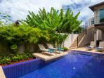 Private swimming pool with integral Jacuzzi and feature sun deck