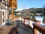 Deck off great room with hot tub, BBQ and mountain views