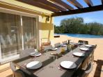 Outside dining area with an electric sun shade over table when required.