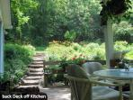 south facing back deck & stairs leading to hiking trails