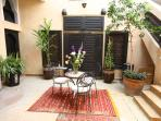 Patio after the entrance. Here you are welcome with a mint tea at your arrival