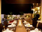 Outdoor Dining table in Sala, adjacent to swimming pool to enjoy al fresco dining or BBQs