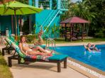 Comfortable sun loungers and parasols at the poolside for sunbathing!