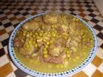 Tajine de viande de veau aux petits pois et artichauts.