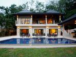Spacious garden and pool area surround this imposing villa