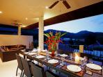 Large outside covered balcony with large dining table for 12 guests