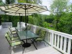 The large deck has seating for 8, a grill, & a view of peaceful Lake Hosea.