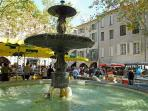 Market day in Uzes, Place aux Herbes