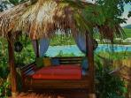 Thatch roof cabana with daytime bed for relaxing etc!