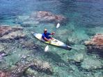 Take our kayaks and explore the clear caribbean sea