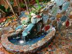 Stone water fountain for ambience, makes you feel like you are at a spa