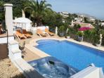 View from the villa and upper terrace of pool, jacuzzi and lower terrace
