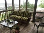 Screened in porch and outside deck for grilling on a CharBroil gas grill
