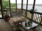Screened in porch featuring the swing and and a deck leading down to the 1st and bottom floor