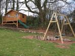 Swings and playhouse in the gardens