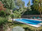 Sit there and relax in this mature garden by the pool in the sunshine
