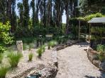 Grass garden leading to Pergola