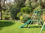 Sunny lawn and play equipment.