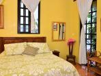 ground floor bedroom with Queen size bed and en suite bathroom