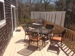 Full deck with southern exposure.  Lots of NEW patio furniture pictured here.