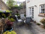 Pet friendly apartment with a fully enclosed courtyard garden with patio doors from the lounge