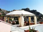 Terrace with gazebo and stunning views on Taormina, the coast line of Calabria and Giardini Naxos