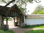 Lychgate by the thatched wall that surrounds the garden