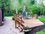 Our new 'Lower' decked area outside the lodge. Ideal to relax on.