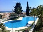 Stunning communal pool manicured gardens+ view of shimmering Med sea beyond