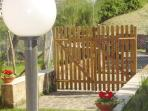 wooden gate, entrance, 40 meters from the train station