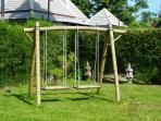 Childrens swing set, with see-saw close by