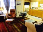 Suite #4  sitting/dining/kitchen 32' flat screen tv
