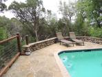 The pool /spa area w/ large deck is off the main house and overlooks the springfed creek and hills!