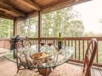 Enjoy the mountain air from the screened in porch