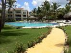 Just a few footsteps from the refreshing infinity pool surrounded by lounge chairs and a lanai