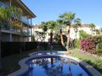 Miramar garden and pool with evening sun