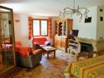 Living/dining area in villa - with TV/DVD/Freesat channels and DVD/reading library