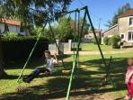 large garden with childrens playground