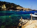 Cala Vadella by the boathouses