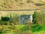 Kilmartin Castle on the hill side
