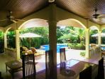 AL FRESCO DINING ON THE SHADED TERRACE NEXT TO THE POOL