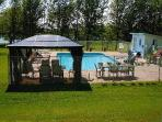 20X40 in-ground pool area, screened gazebo, kids slide, lounge chairs