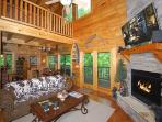 Living Room with Stone Stacked Fireplace - Gas