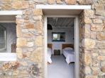 Stone-built guesthouse entrance.
